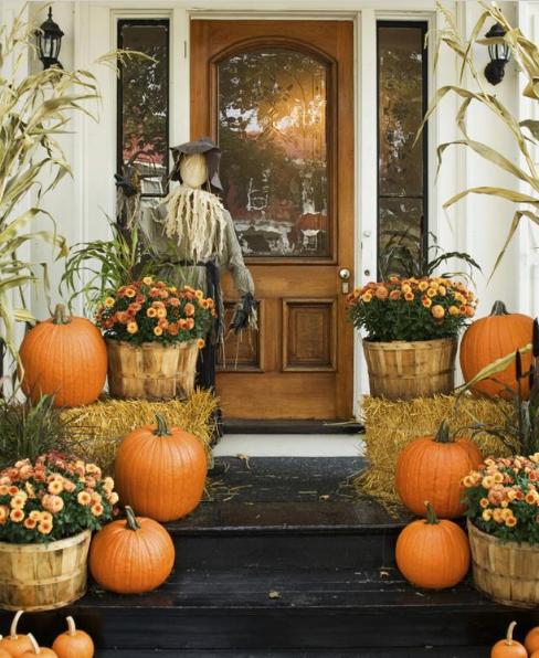 autumn-door-with-scarecrow-and-bales-of-hay