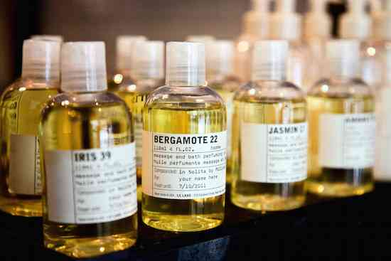 Small vials stand on Le Labo's main counter in the New York City Nolita store on Friday, Aug. 20, 2010. The main ingredient of each fragrance determines the name displayed on the labels, while the apposed number refers to the total number of ingredients used for each concoction.